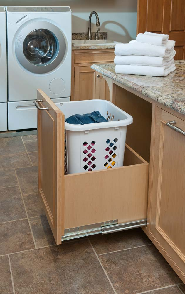 Slide out laundry hamper custom built by Crown Point Cabinetry