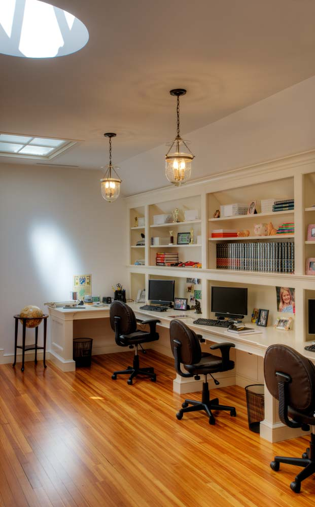 Custom home office desk cabinetry by Crown Point Cabinetry