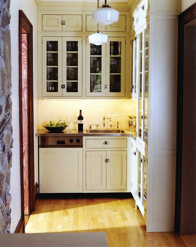Custom pantry cabinetry with door over door arrangement by Crown Point