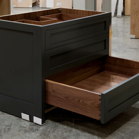Three Drawer Base Cabinet with Pipe Chase - Bottom Drawer Open