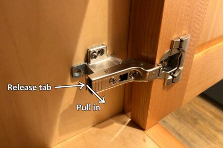 Blum hinge adjustment - Removing hinge